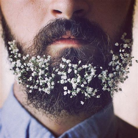 flowers in their men with beards guys are decorating their beards with flowers and it s