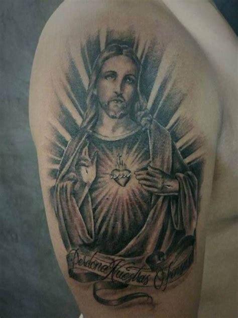 jesus tattoo on arm pics jesus portrait tattoo upper arm tattoo tattooed