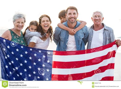 An American And Happy Family With An American Flag Stock Photo Image 68297745