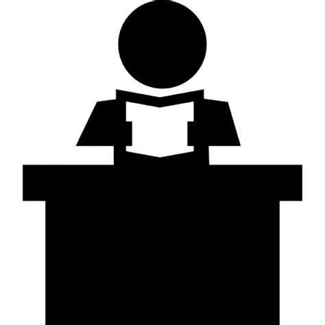 schreibtisch icon lehrer liest ein buch sitzt hinter seinem schreibtisch