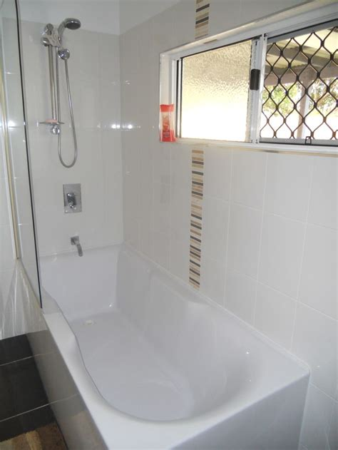 corner bath with shower screen a corner freestanding bath with a bath screen and shower