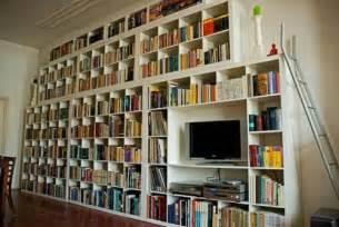 wall of bookshelves ganging up ikea shelves for a striking cheapass wall o