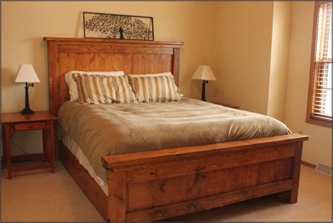 rustic wooden bed frame with headboard and footboard using
