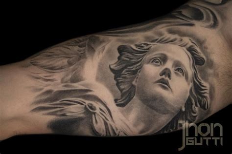 realistic angel tattoo designs statue by jhon gutti tattoonow
