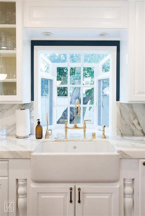 kitchen cabinets with windows behind antique brass vintage kitchen faucet with farm sink