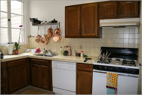 staining kitchen cabinets darker before and after refinished kitchen cabinets before and after the