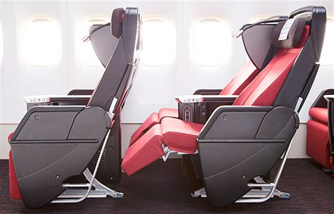 comfort on long flights japan airlines cuts seats to increase comfort on long haul