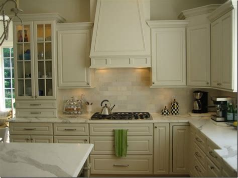 ivory subway tile backsplash kitchen cabinets design ideas