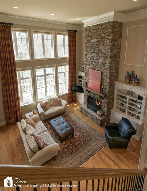 story room best 25 two story fireplace ideas on two story houses living room with windows and