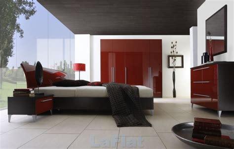 comfortable red bedroom design  light woods  dim