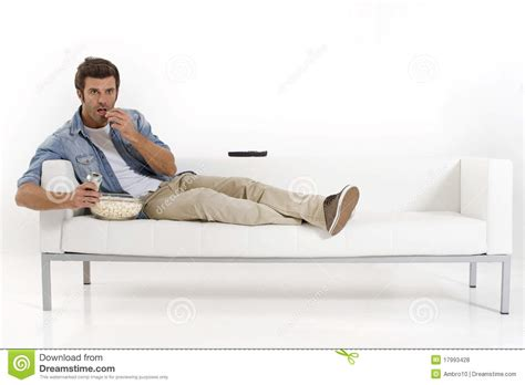 a man and a couch single man on the couch watching tv royalty free stock