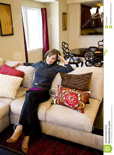 sitting in living room middle aged relaxing on living room sofa stock images image 11754024