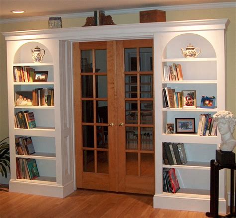 custom arched bookcases by homecoming woodworks