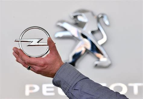 opel psa it s official peugeot citroen buys vauxhall opel for 1 3