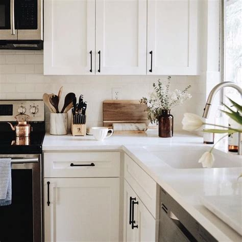 modern black kitchen cabinet handles white cabinets with black hardware the everygirl