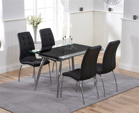 Black Glass Extending Dining Table Ritz Black Extending Glass Dining Table With Calgary Chairs The Great Furniture Trading Company