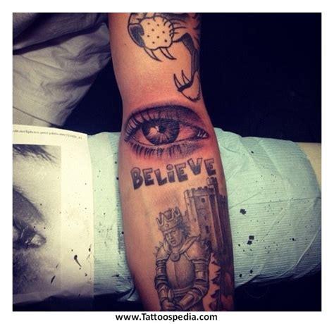 cross tattoo left or right tony baxter