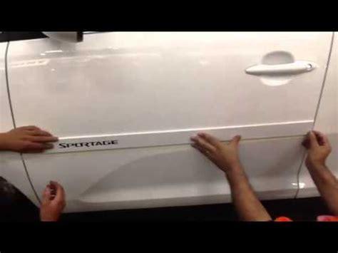 friso lateral original instalado no kia sportage 2013