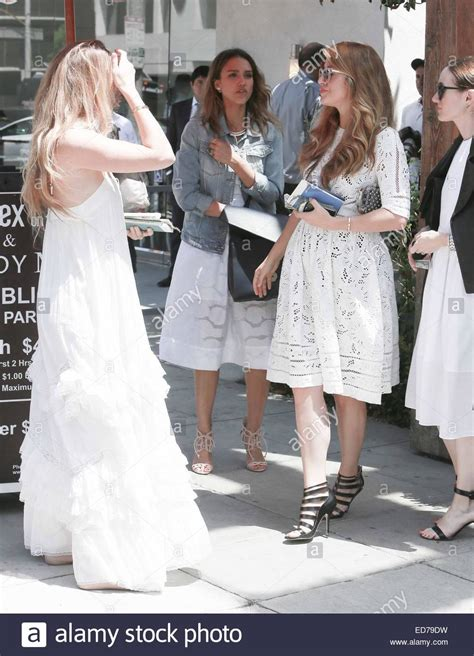 White Demin Wedding Dresses by Alba Wears A White Dress And Denim Jacket To A