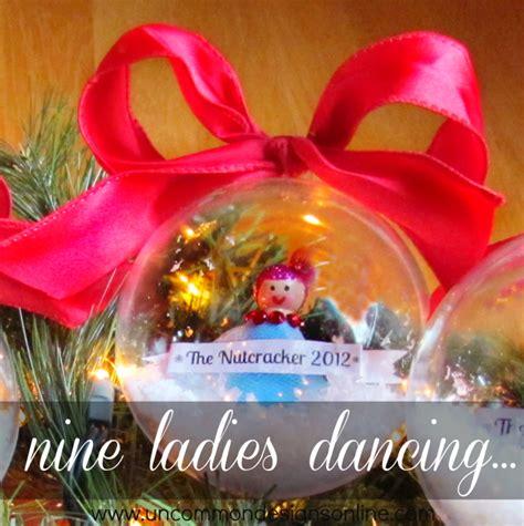 9 ladies dancing peg doll snow globe ornament