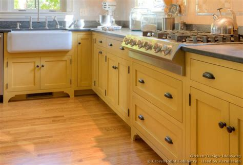 traditional yellow kitchen with a custom wood island traditional yellow kitchen with a custom wood island