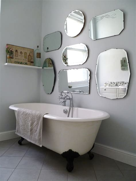 Mirror Wall In Bathroom How To Hang A Display Of Vintage Mirrors Decorator S Notebook