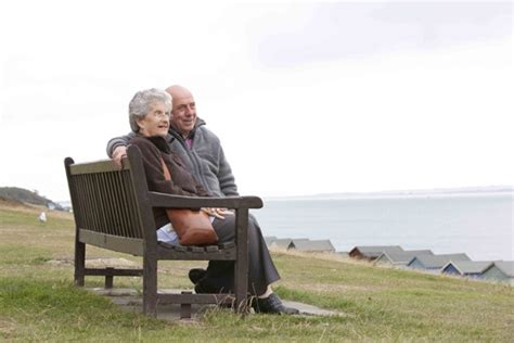 old couple on park bench superstock old couple sitting on park bench together male models picture