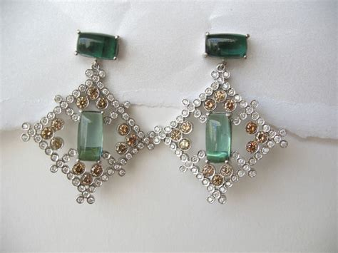 obama wears earrings by esses