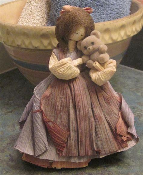 corn husk dolls by nan nan s corn husk doll holding teddy 1985