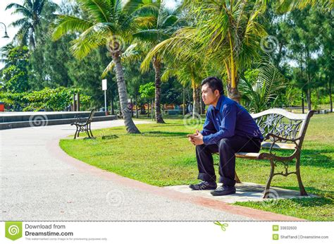 sitting on the bench young man sit on the bench stock photo image 33632600
