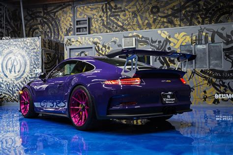 porsche 911 gt3 rs ultraviolet porsche 911 gt3 rs poses with pink wheels