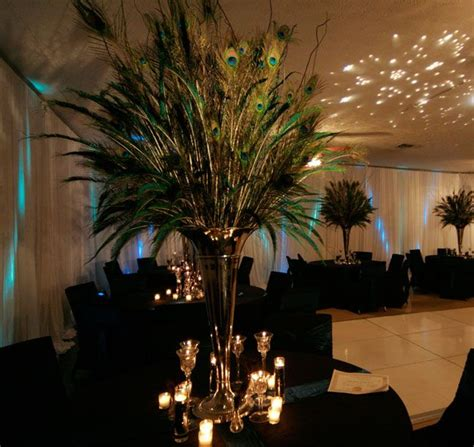 large silver vases with peacock feathers elliott event s