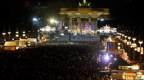 crowds gather at brandenburg gate for new year in berlin
