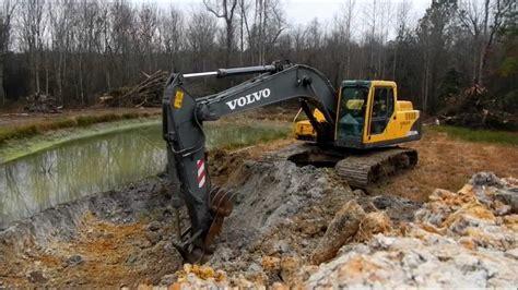 volvo  excavator extending pond youtube