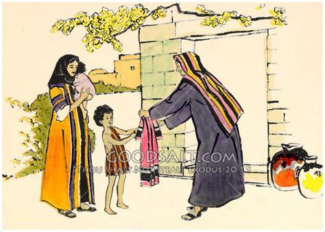 Dorcas Hands Clothes to Child