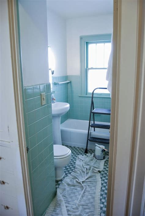 bathroom gets an overhaul fresh white paint with seafoam green tile is the way to go couldn t