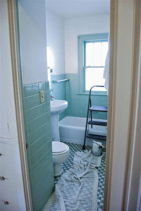Bathroom gets an overhaul. Fresh white paint with seafoam