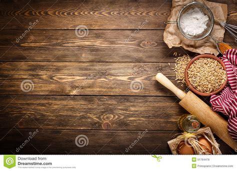 Ingredients For Baking On Empty Dark Wooden Background