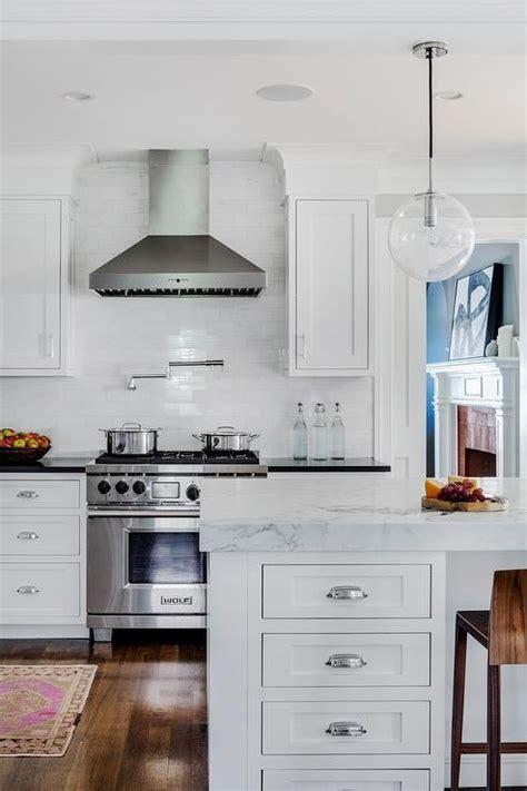 steel kitchen range with white beveled subway