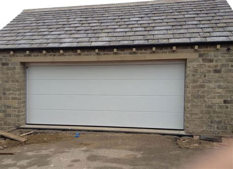 sectional door installation protec garage doors ltd garage door suppliers and