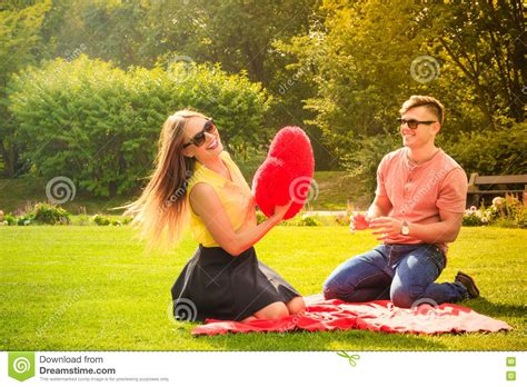 golden couple have big hearts couple with big heart on picnic stock photo image 70806268