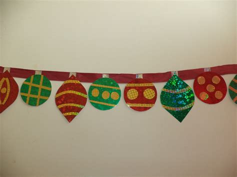 diy decorations with construction paper sparkling paper ornaments banner allfreechristmascrafts