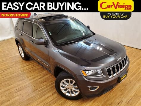 pre owned  jeep grand cherokee laredo navigation