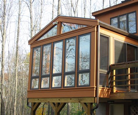 Difference Between Conservatory And Sunroom differences between sunrooms and conservatories sunspace design