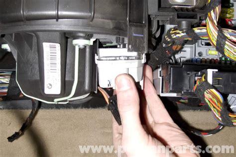 unplug blower motor resistor bmw e90 blower motor replacement e91 e92 e93 pelican parts diy maintenance article