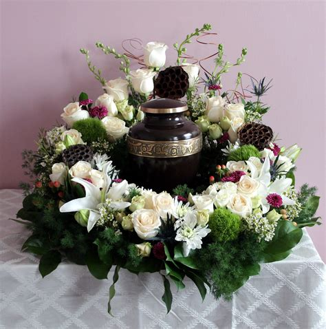 1 year memorial flowers white purple with pods 360 degree urn arrangement created