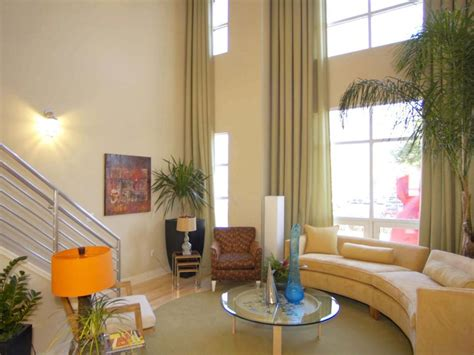 two story family room window treatments search viewer hgtv