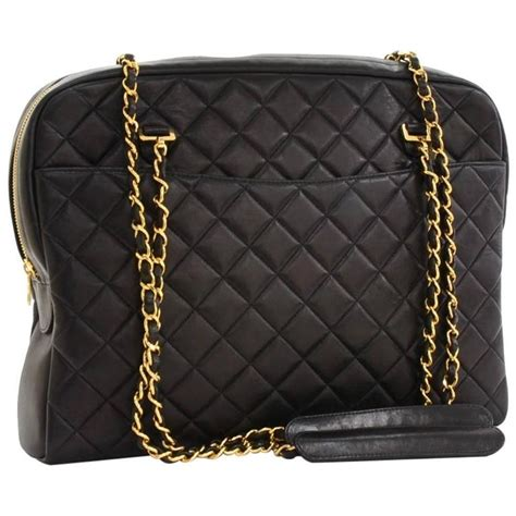 chanel black quilted lambskin gold chain top handle