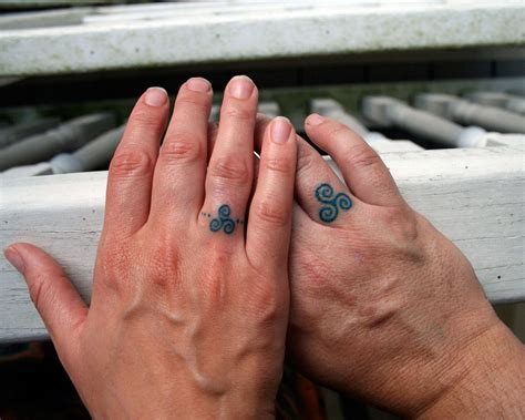 couple wedding ring tattoos make a rocking by astonishing ring tattoos
