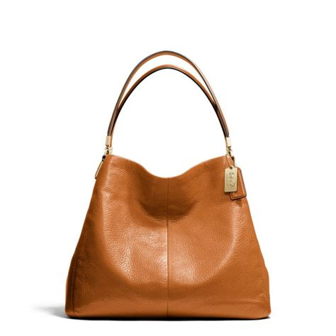 Coach Edie And Coach Phoebe small phoebe shoulder bag in leather coach asian